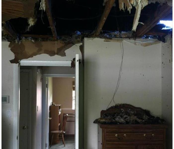 Master bedroom destroyed after fire and water damage