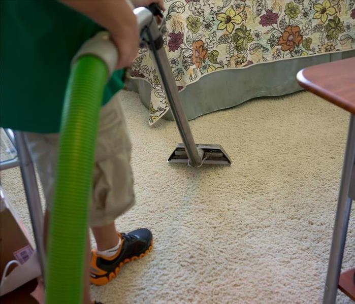 SERVPRO technician cleaning a carpet