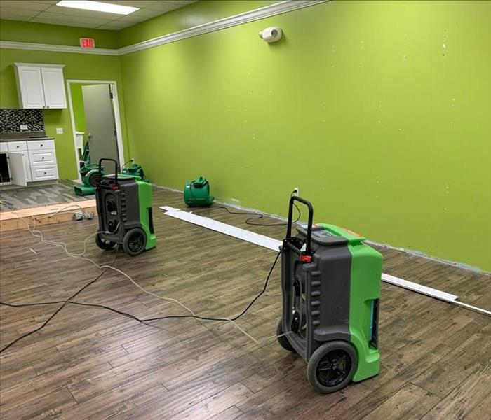 Water damage on the floor of an office