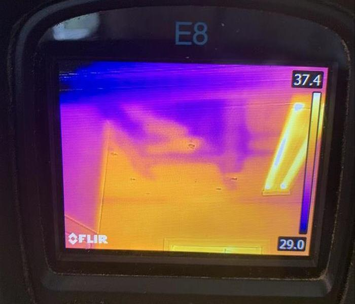 Thermal imaging camera checking for moisture