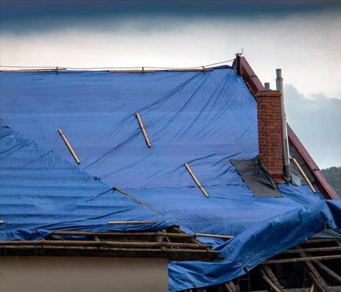 Tarp covering a damaged roof