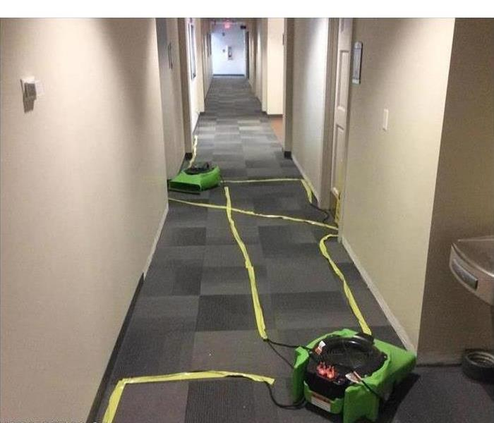Air movers placed in a hallway of commercial building