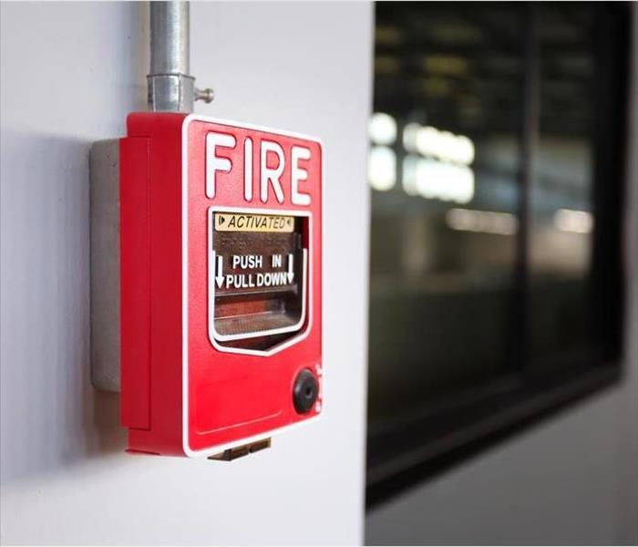 Emergency fire alarm switch on the wall