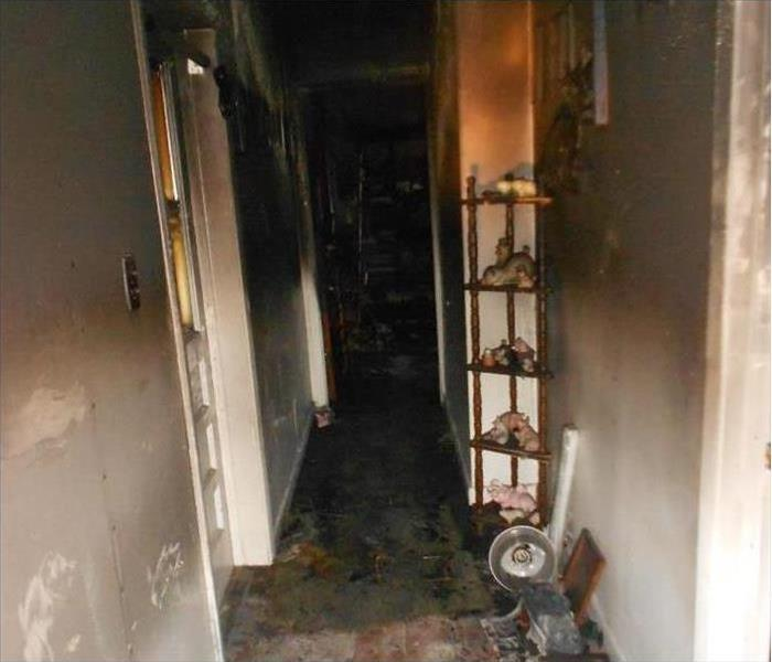 Hallway of a home, walls burned